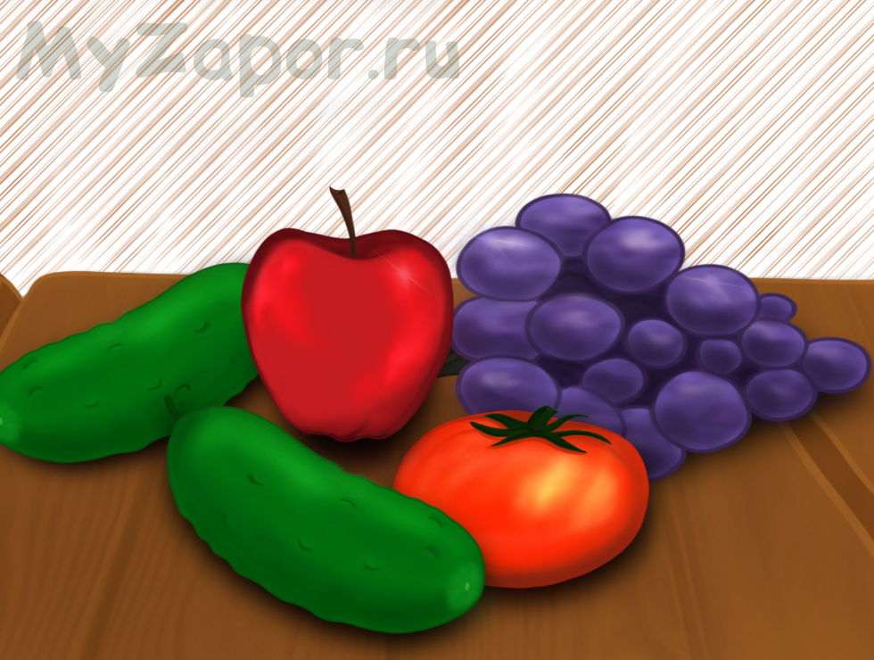 Яблоко, виноград, помидор и огурец на столе